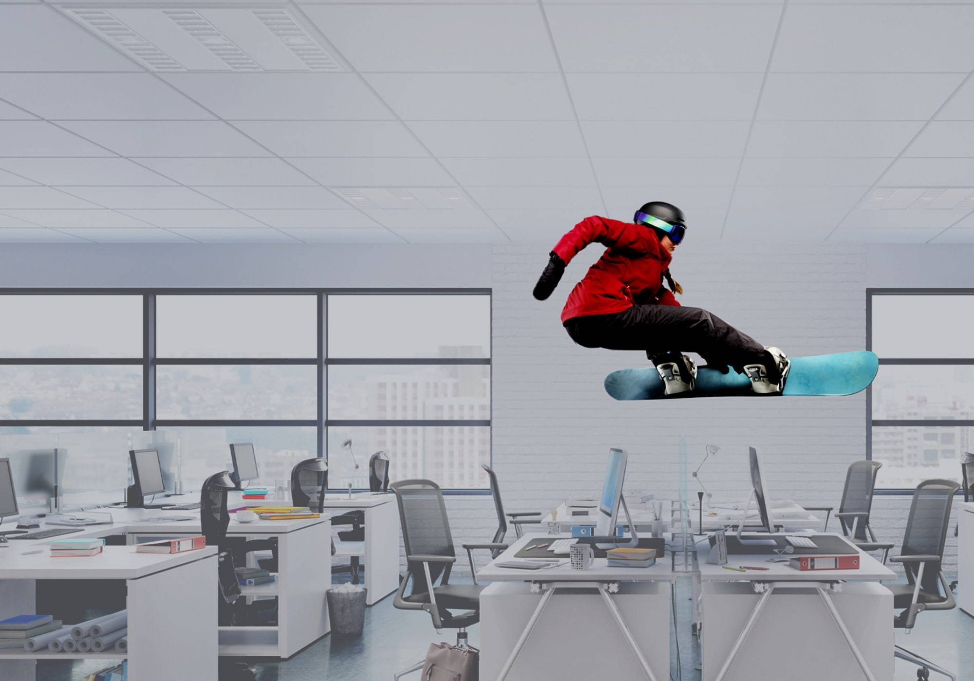 A snowboarding flying over desk set ups to show balance.